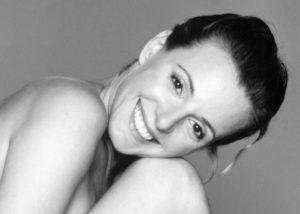 Smiling woman at Tavallali Plastic Surgery